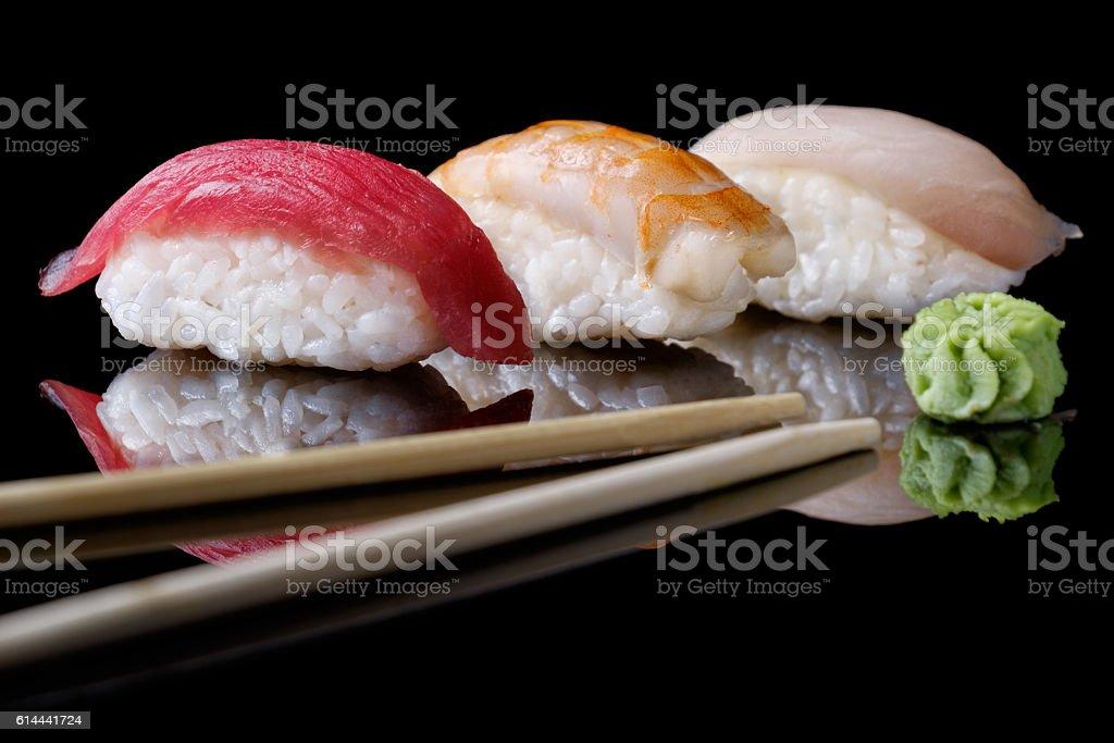 Sushi with vasabi on black stock photo