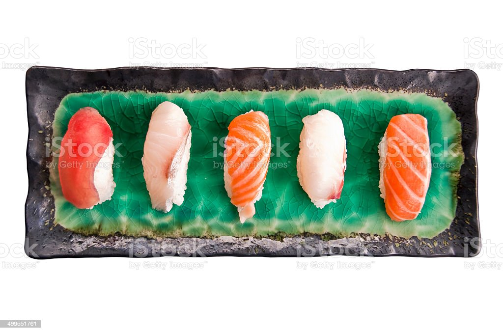 Sushis on a plate isolated on white background royalty-free stock photo