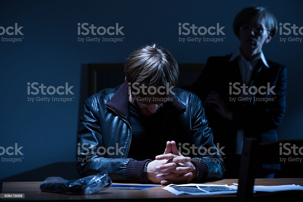 Suspect with head down stock photo