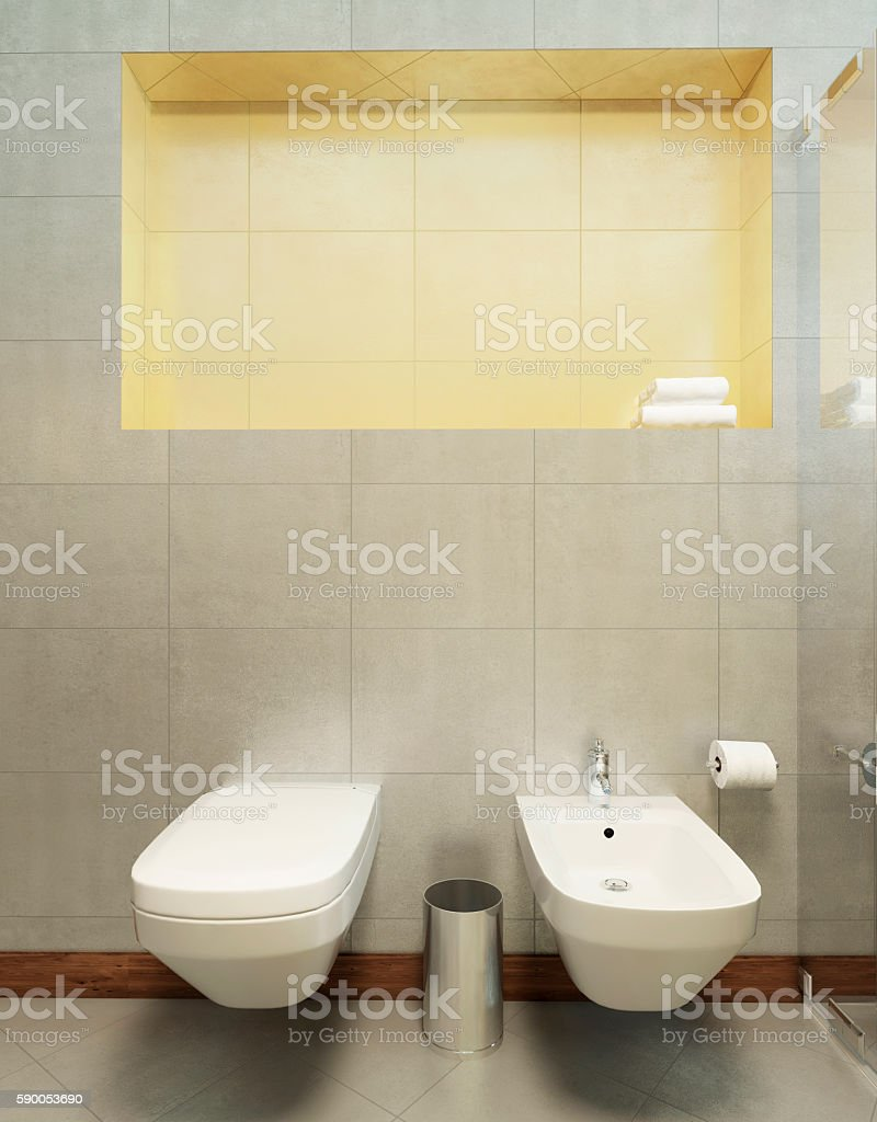 Suspended toilet and bidet on the wall tiles in gray. stock photo