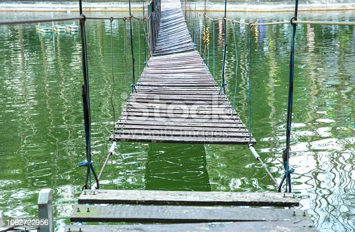 suspension bridge of sling and woods for walk.