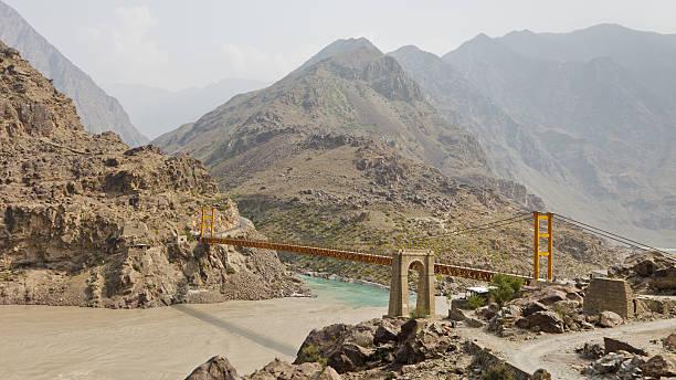 Suspension Bridge across the Indus River, Pakistan Suspension bridge across the Indus River along the Karakorum Highway in Pakistan. silk road stock pictures, royalty-free photos & images