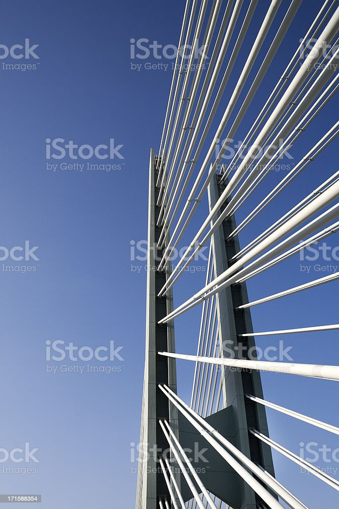 Suspension bridge against blue sky stock photo
