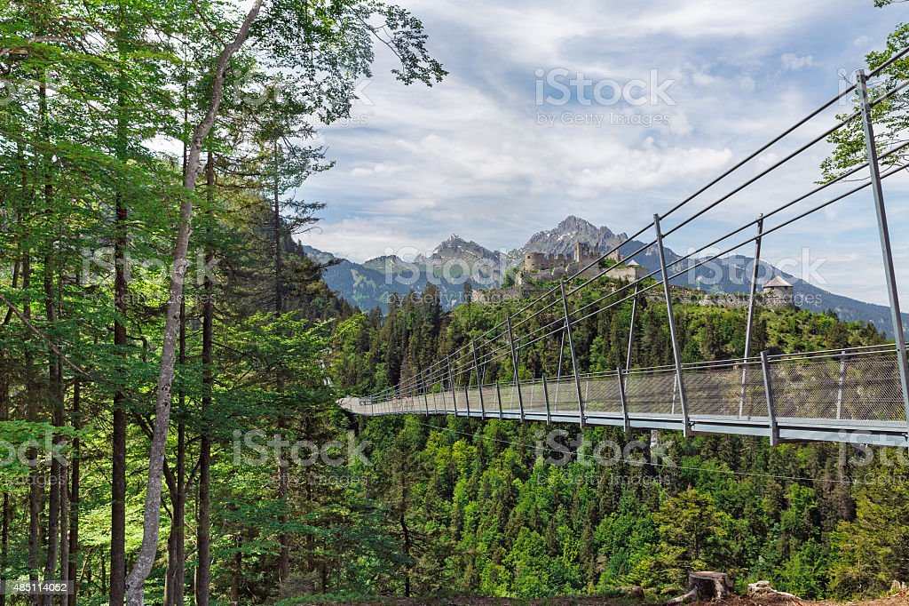 suspension bridge and castle stock photo