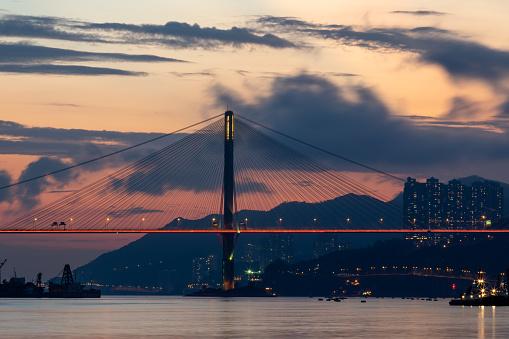 Suspension Bridge Illuminated During Sunset - zdjęcia stockowe i więcej obrazów Architektura