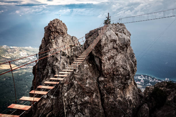 suspension bridge on the mount ai-petri in crimea, russia. - walkway and bridge stock photos and pictures