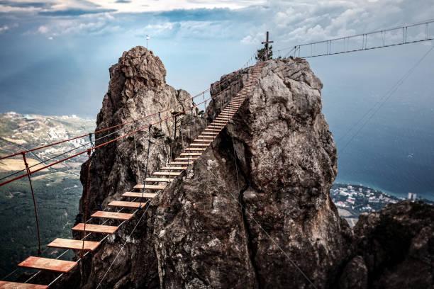 Suspension bridge on the Mount Ai-Petri in Crimea, Russia. Suspension bridge on the Mount Ai-Petri in Crimea, Russia. steep stock pictures, royalty-free photos & images