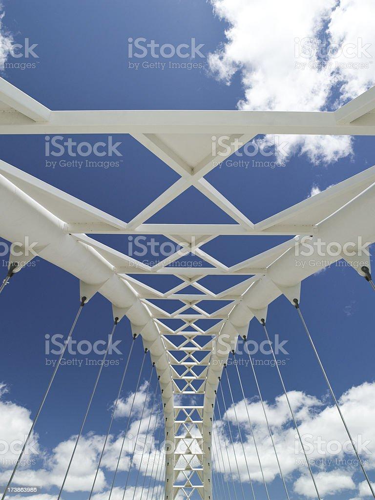 Suspension bridge over a river royalty-free stock photo