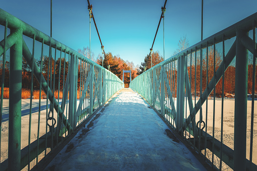 suspension bridge over the frozen river