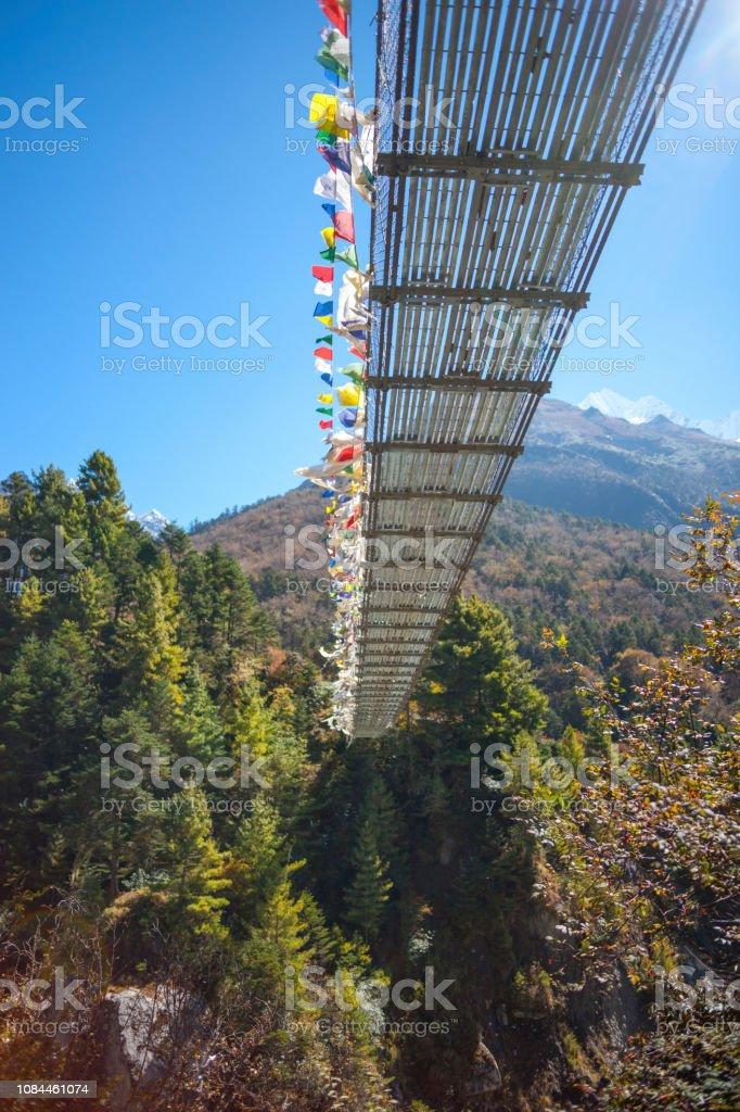 Suspension bridge over the river in Himalayas. Everest base camp trek in Nepal stock photo