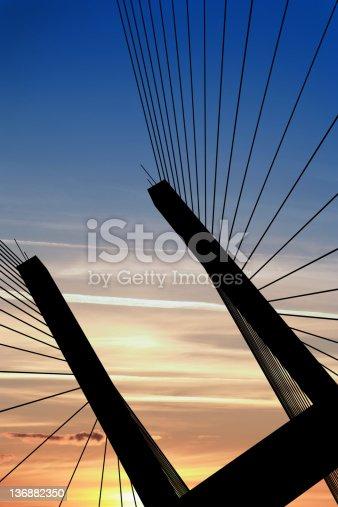 156725382 istock photo XXL suspension bridge silhouette 136882350