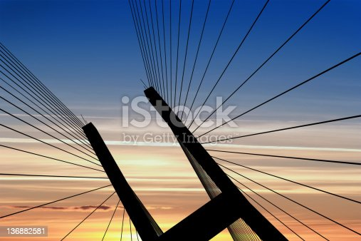 156725382 istock photo XXL suspension bridge silhouette 136882581