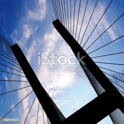 156725382 istock photo XL suspension bridge silhouette 136920070