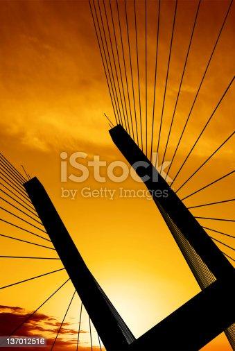 156725382 istock photo suspension bridge silhouette 137012516