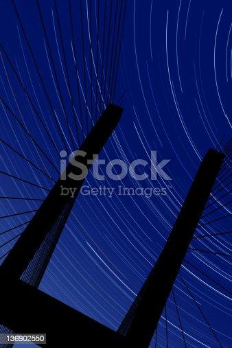 156725382 istock photo XXL suspension bridge silhouette with stars 136902550