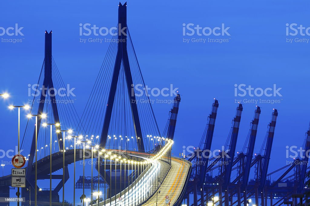 Suspension Bridge With Car Light Trails at Night royalty-free stock photo