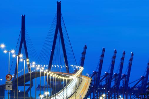 suspension bridge with car light trails at night, Kohlbrandbrucke, Hamburg, Germany, long exposure,