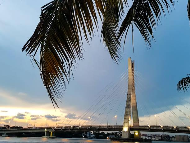 Suspension bridge with lights - Sunset on a bridge - Lagos, Nigeria stock photo