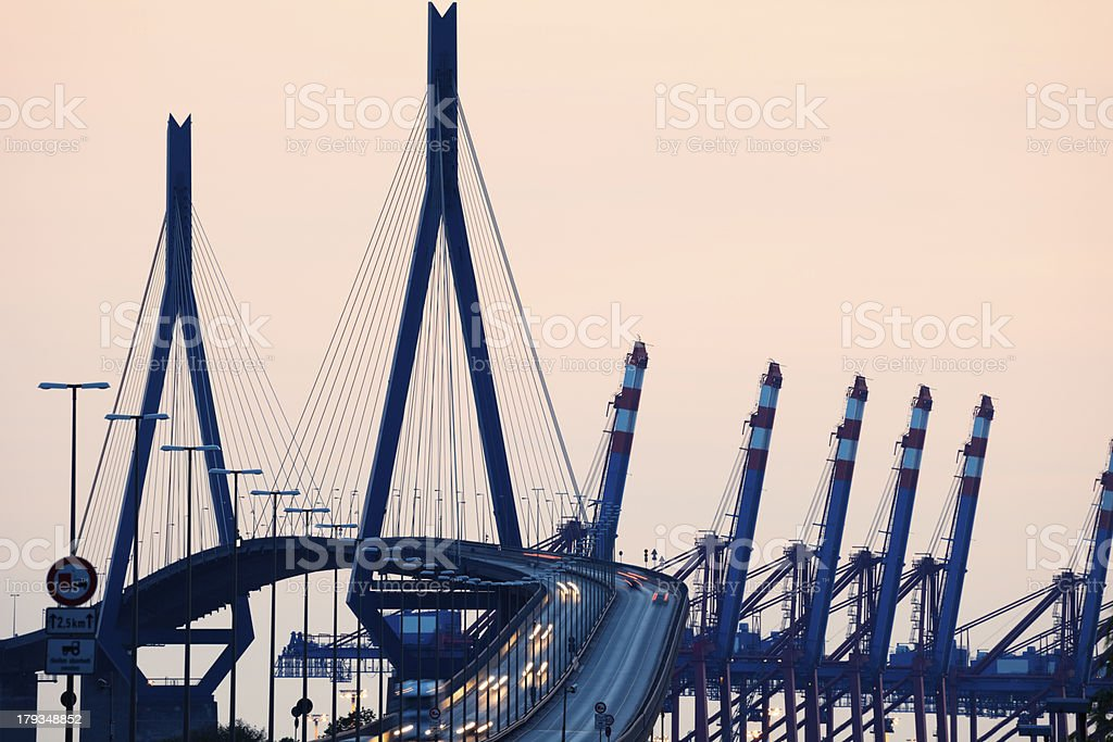 Suspension Bridge With Traffic at Dusk stock photo