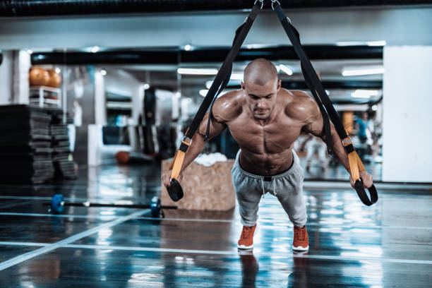 suspension straps exercise in the gym - milan2099 stock photos and pictures