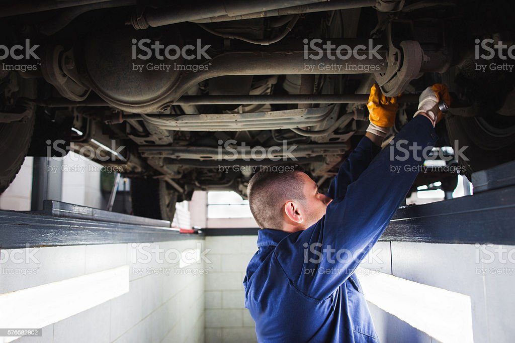 Suspension system of SUV restoration in garage stock photo