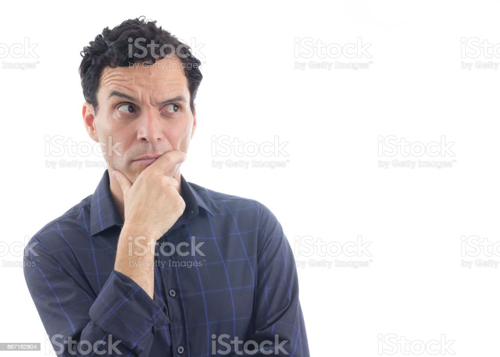 Suspicious man. The person is wearing dark blue social shirt. Isolated.'n stock photo