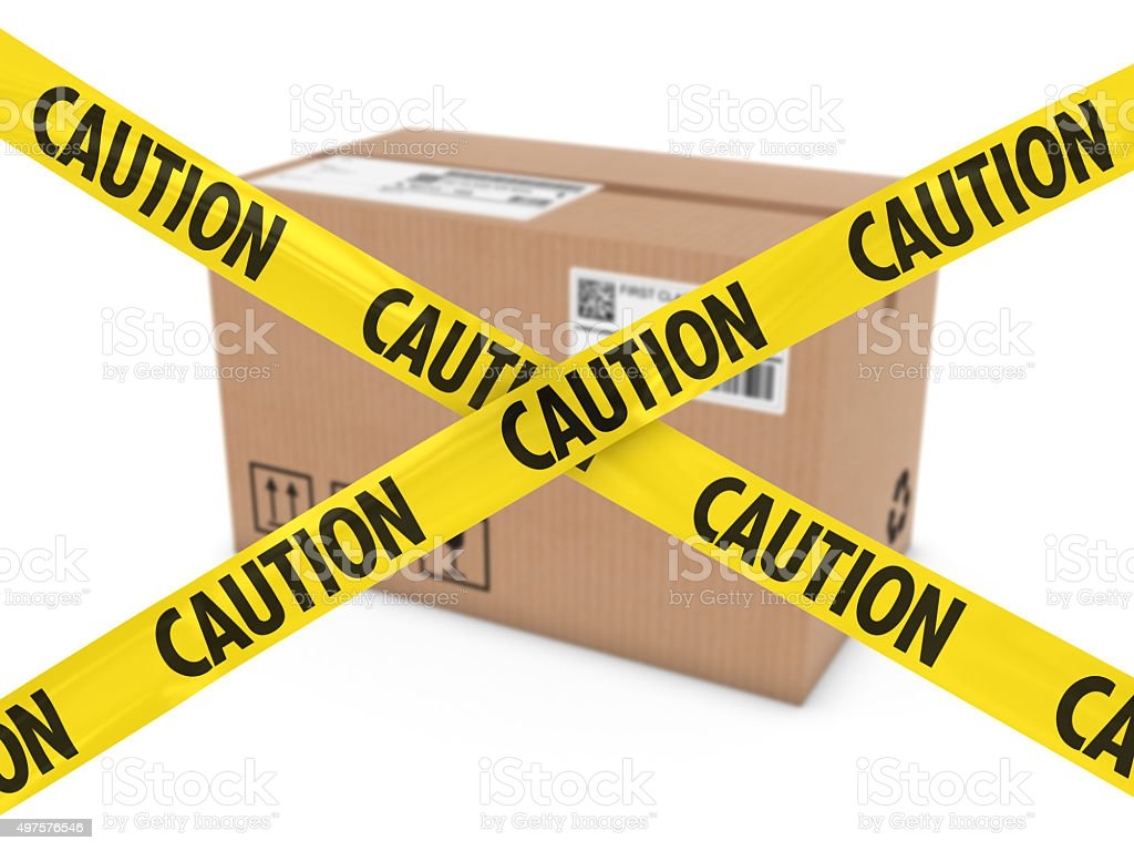 Suspicious Parcel Concept - Cardboard Box behind Caution Tape Cross stock photo