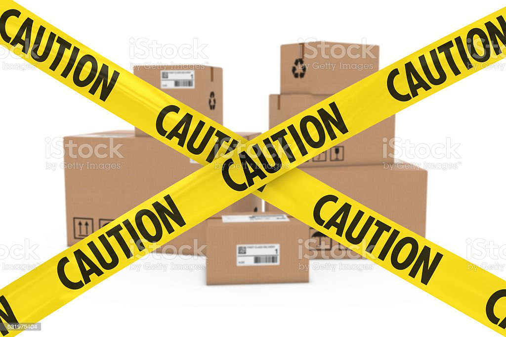 Suspicious Parcels Concept - Cardboard Boxes behind Caution Tape Cross stock photo