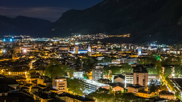Sustainable city, lights and traffic in mountain valley, Trento, Italy stock photo