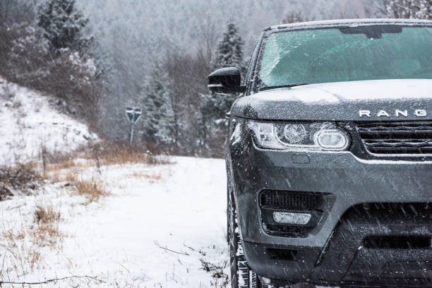 Suv off-road vehicle on a snowy mountain,1 Monte Grappa, Treviso, Italy - December 27, 2014: A Range Rover Sport 4x4 explores a wooded trail after a recent snow storm. range rover stock pictures, royalty-free photos & images