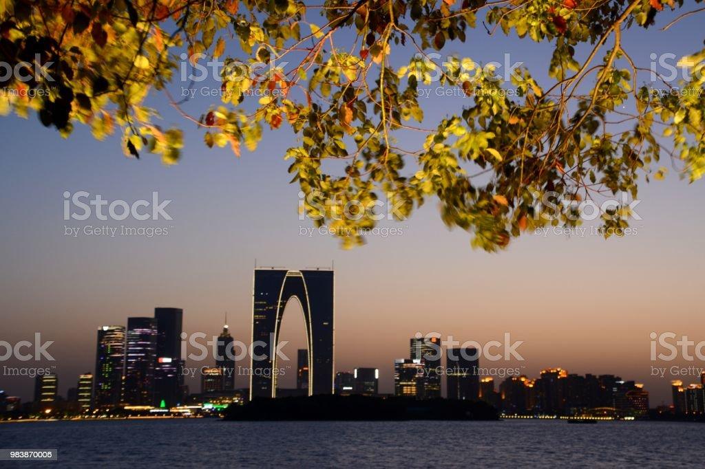 Suzhou SIP skyline at dusk on Jinji lake, Jiangsu, China stock photo