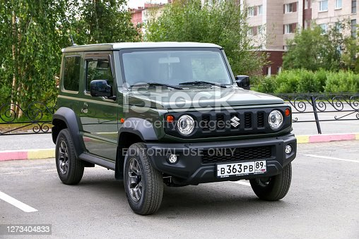 Novyy Urengoy, Russia - July 15, 2020: Compact offroad vehicle Suzuki Jimny in the city street.