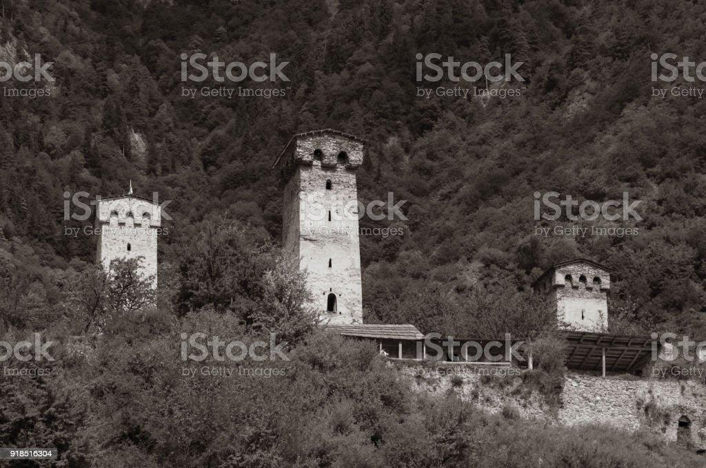Svaneti towers against mountains background. stock photo