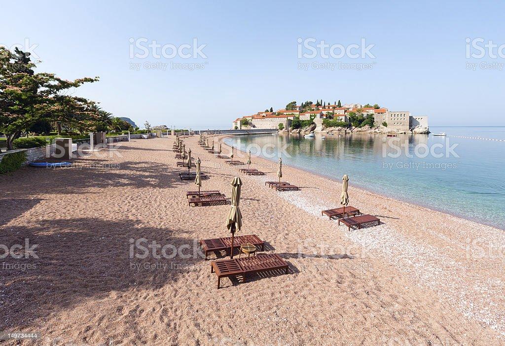 Sveti Stefan sea islet morning view with sandy beach (Montenegro royalty-free stock photo