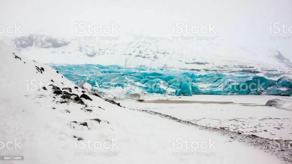 Svinafellsjokull glacier view during winter snow in Iceland stock photo