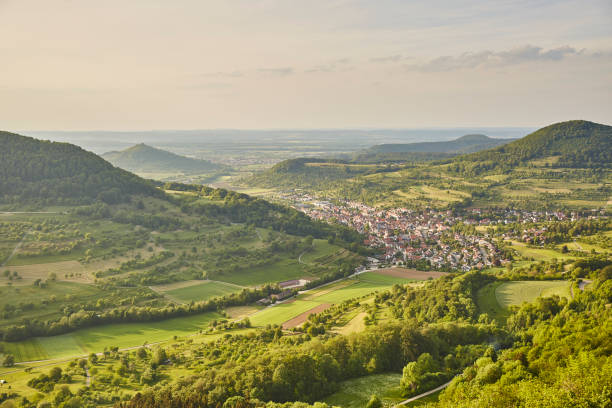 Schwäbische Alb Beautiful View Hilly Landscape green village horizon cloudscape village stock pictures, royalty-free photos & images