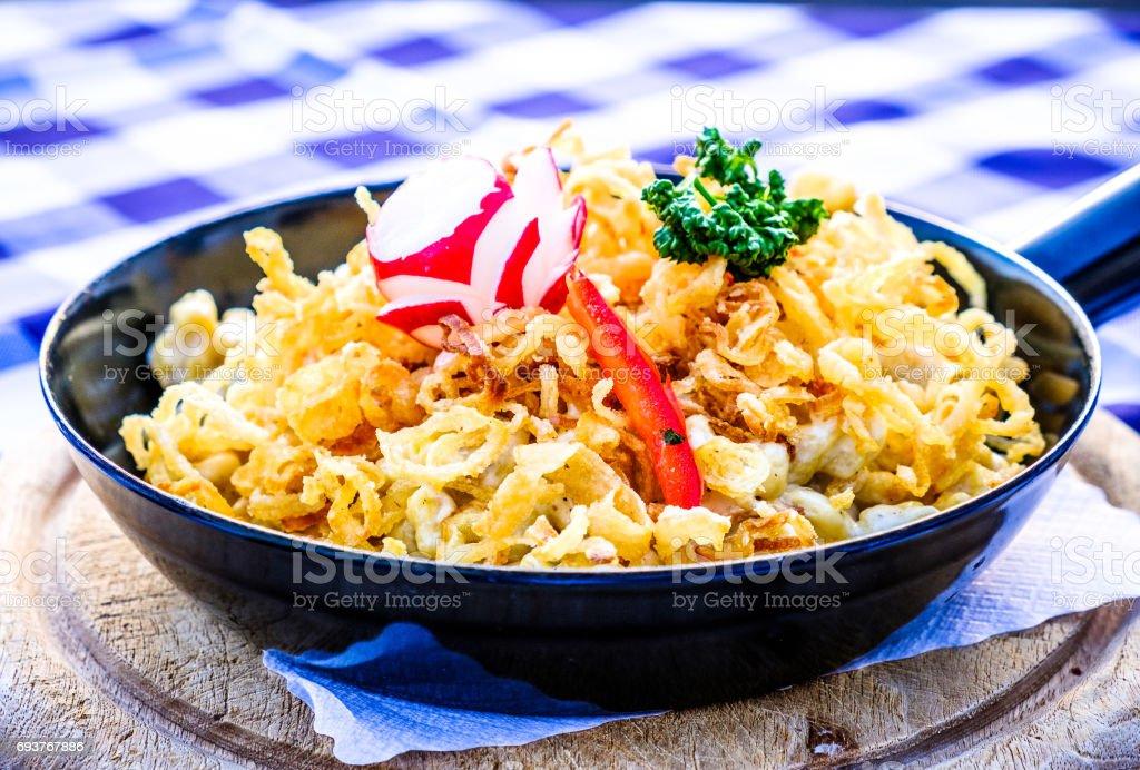 swabian noodles - kaesespaetzle stock photo