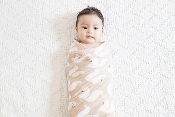 Swaddle A cute asian baby being swaddled baby blanket stock pictures, royalty-free photos & images
