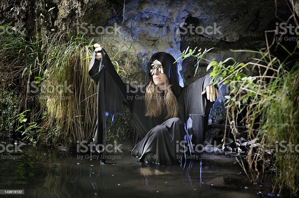 swamp hag in magic cave royalty-free stock photo