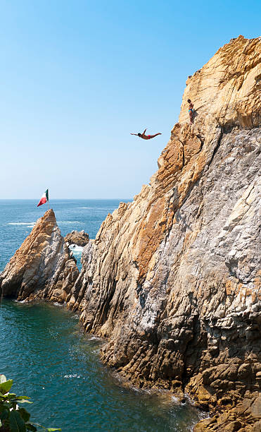 Swan dive from the Cliffs of Acapulco stock photo