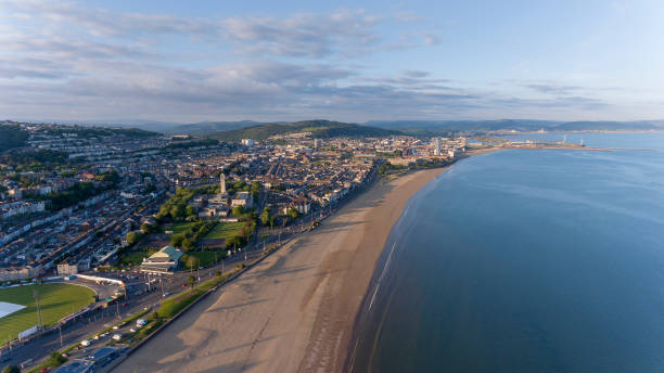 Swansea South Wales UK Editorial SWANSEA, UK - June 2, 2018: An aerial view of Swansea Bay, South Wales, UK, showing Victoria Park to the city centre bay of water stock pictures, royalty-free photos & images
