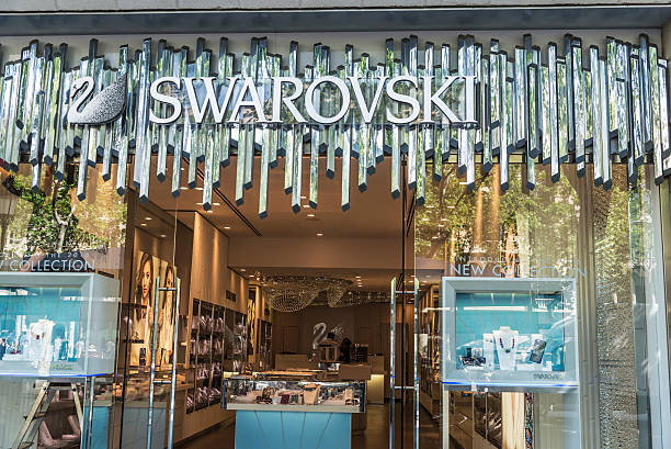 Swarovski shop, Barcelona Barcelona, Spain - May 25, 2016: Swarovski shop located on Passeig de Gracia, one of the most expensive streets in Europe. gracia baur stock pictures, royalty-free photos & images