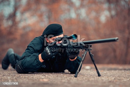 istock Swat Police Officer Shooting With Firearm 1090637908