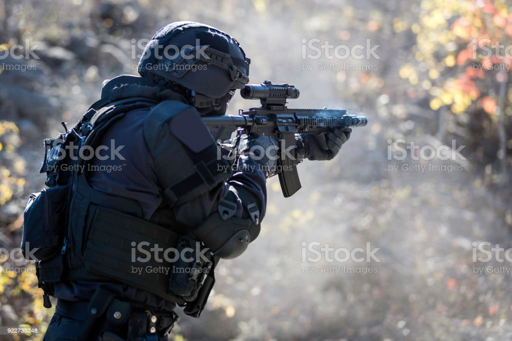 Swat Police Officer Shooting With Firearm stock photo