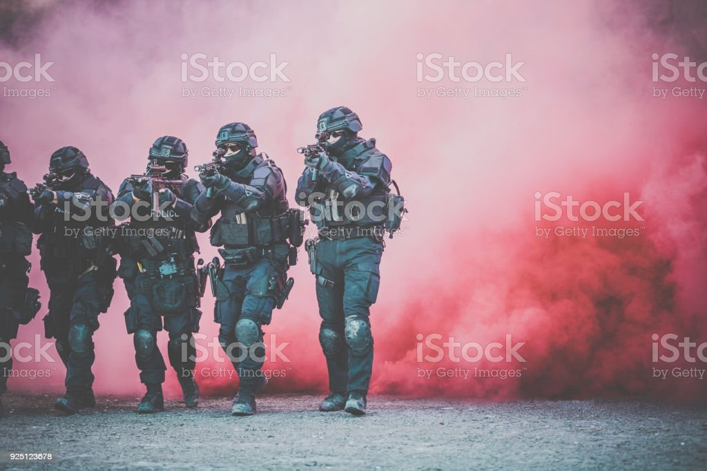 Swat Police Officers Shooting With Firearm stock photo