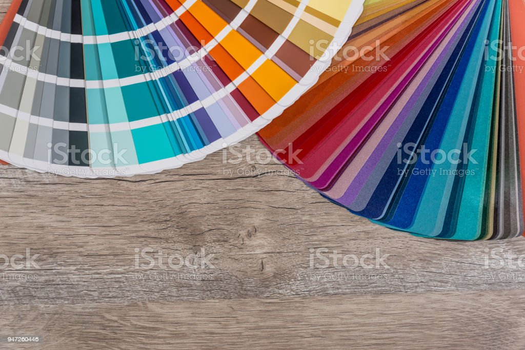 Swatch of colouring on wooden table background stock photo
