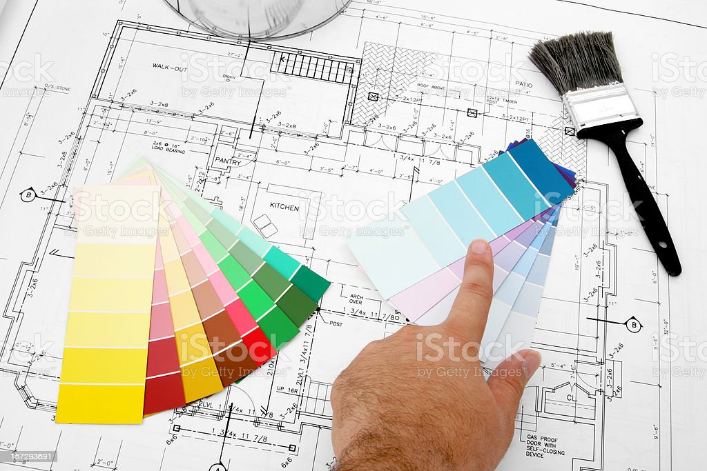Swatches of color on top of a blue print royalty-free stock photo