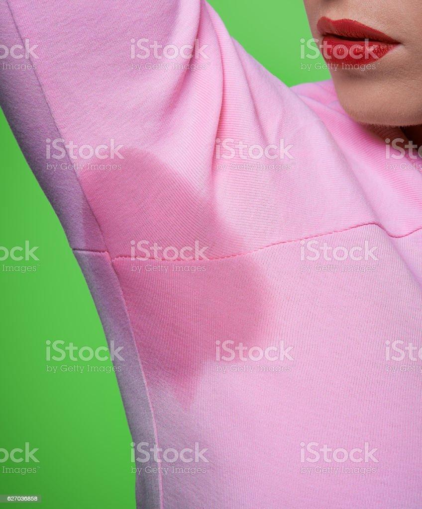 sweat mark on pink blouse stock photo