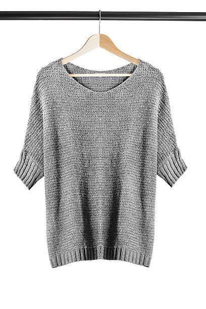 sweater on clothes rack - garderobenhaken stock-fotos und bilder