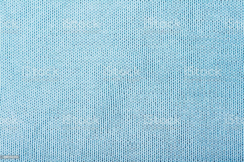 Sweater or scarf fabric texture large knitting. Knitted jersey background with a relief pattern. Wool hand- machine, handmade, blue stock photo
